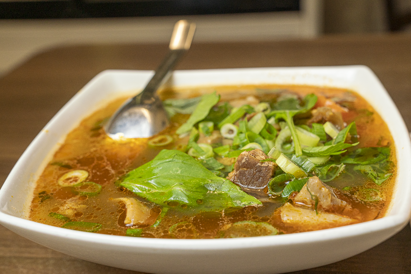 Bò kho (Beef stew with bread or noodle)